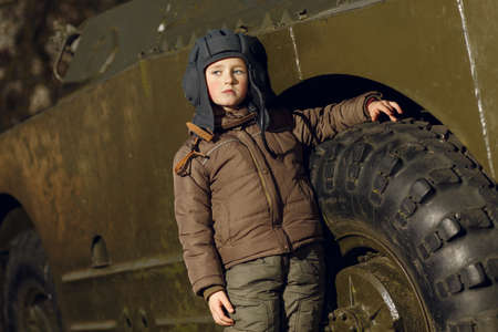 Panzer: Portrait of young boy standing near by panzer Stock Photo
