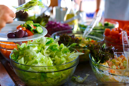 trays: Salad buffet. The people themselves impose the desired treat.