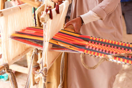 bedouin: A man produces the fabric on a traditional loom in the Bedouin village, Egypt