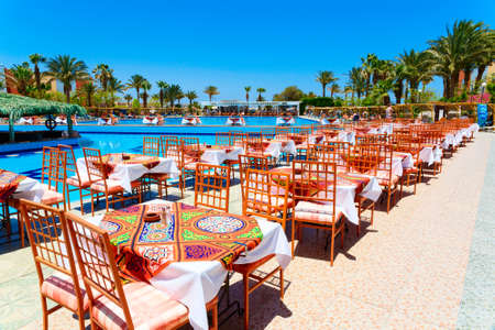 hurghada: HURGHADA, EGYPT - MAY 16, 2015: Swimming pool with tables for the meal