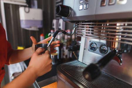 barmen: Bartender making coffee in pub, bar, restaurant