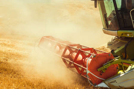 agriculture machinery: combine harvester working on a wheat field Stock Photo