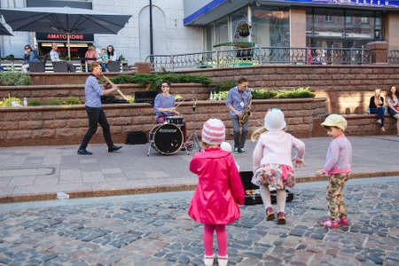 cantal: HRODNA, BELARUS - JUNE 27, 2015:  Street musicians play on The Annual International Big-Mini-Festival of Street and Area Art