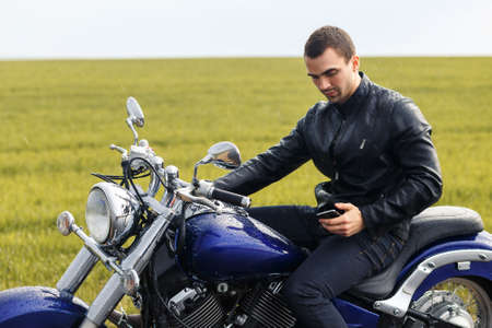 stoppage: Young biker have a stoppage for chatting with somebody Stock Photo