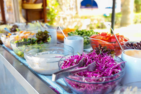 desired: Salad buffet. The people themselves impose the desired treat.