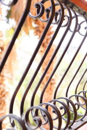 stile: Decorative, forged banisters, fence in old stile. Stock Photo