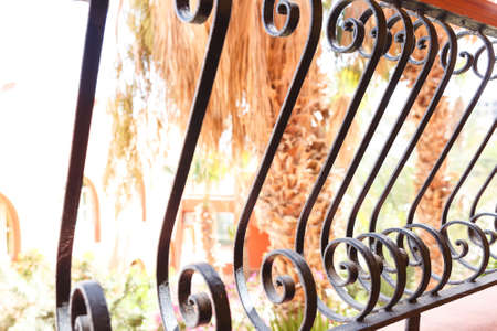 banisters: Decorative, forged banisters, fence in old stile. Stock Photo