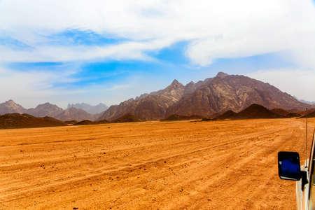 lifeless: Lifeless hot desert with mountains in Egypt, Africa Stock Photo