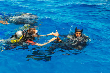 padi: HURGHADA, EGYPT - MAY 19, 2015: scuba diving lesson with trainee and instructor