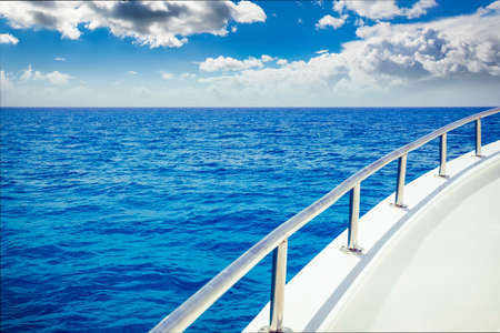 cruise: vacation, travel, cruise and leisure concept - close up of sailboat or sailing yacht deck and sea Stock Photo