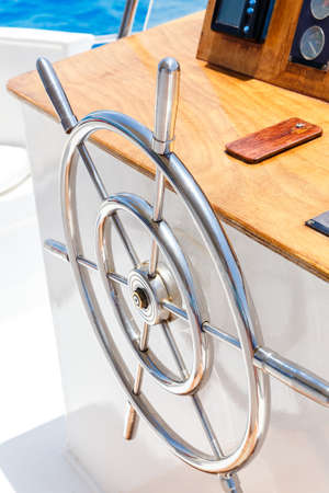 yacht people: Sailing yacht control wheel and navigation implement. Horizontal shot without people