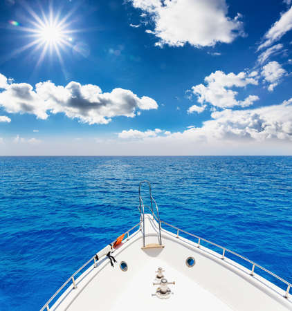 leisure time: vacation, travel, cruise and leisure concept - close up of sailboat or sailing yacht deck and sea Stock Photo