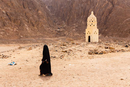 yashmak: HURGHADA, EGYPT - MAY 18, 2015: Unidentified bedouin girl in the village on the desert near Hurghada. This Village is one of main tourist attractions on desert in Egypt.