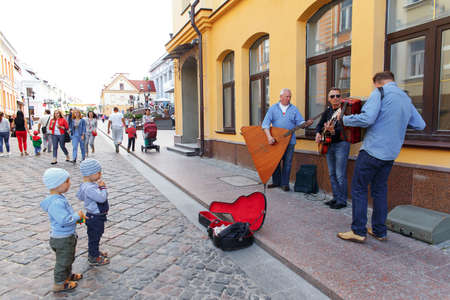 show cases: HRODNA, BELARUS - JUNE 26, 2015: Street musicians playing on the street of Hrodna