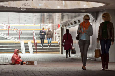 waif: HRODNA, BELARUS - OCTOBER 04, 2012: Homeless baby girl begging in underpass Editorial