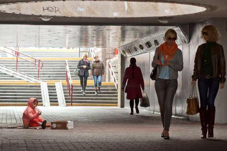 HRODNA, BELARUS - OCTOBER 04, 2012: Homeless baby girl begging in underpass Editorial