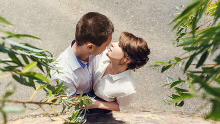 lovers kissing: Portrait of two beautiful young lovers kissing in the park