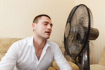 Guy gets pleasure substituting face the wind from fan