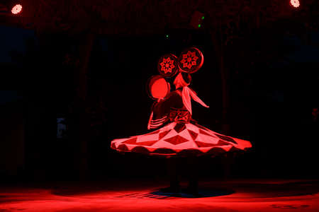 sufi: HURGHADA, EGYPT - MAY 18: A Sufi dancer spins with a drums during a national egyptian dance on tourist show near by Hurghada, Egypt on May 18, 2015