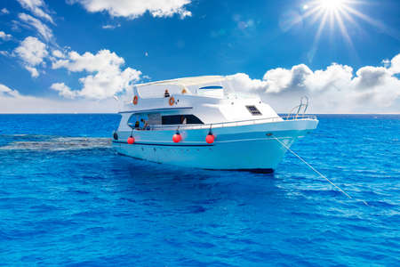 dive trip: White yacht in the blue tropical sea, diving safari boat for liveaboard
