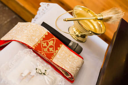 bible altar: Rings, towel, microphone and brush prepared for wedding ceremony