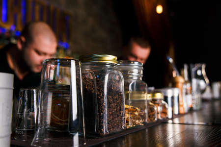 bartenders: GRODNO, BELARUS - NOV 7, 2015: Two bartenders quickly working at a gastrobar HOUDINI in Grodno, Belarus, November 7, 2015 Editorial