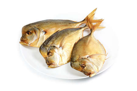 meat and alternatives: Smoked moonfish on plate isolated on a white background