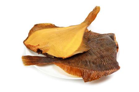 plaice: Two hot smoked flatfish on plate isolated on white