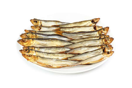 sprat: Plate with smoked Baltic sprat isolated on white background Stock Photo