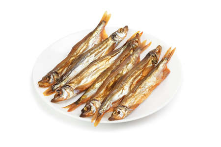 Plate with smoked capelin isolated on white background