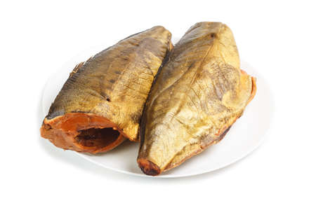 beheaded: Cold smoked mackerel on plate isolated on a white background