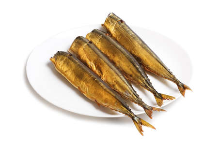 beheaded: Cold smoked saury on plate isolated on a white background