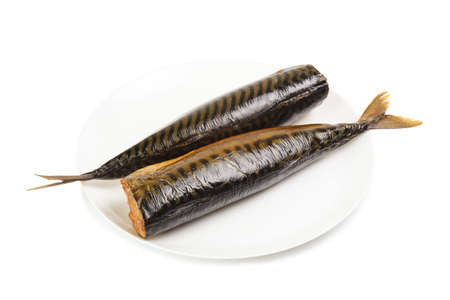 beheaded: Hot smoked mackerel on plate isolated on a white background