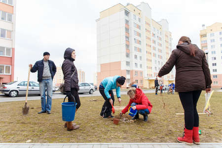 hause: GRODNO, BELARUS - MAR 26: residents of hause plant trees in the yard. Mart 26, 2016 in Grodno, Belarus