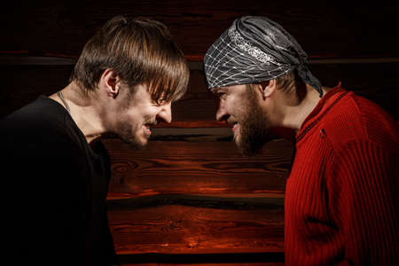 outcry: Confrontation. Conceptual picture. Two brutal man looking into each others eyes