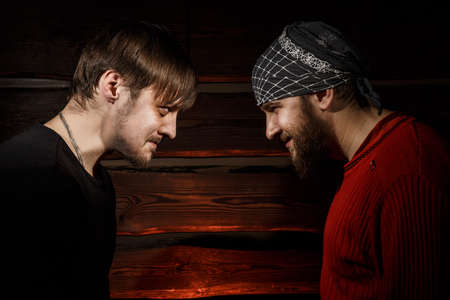 standoff: Confrontation. Conceptual picture. Two brutal man looking into each others eyes