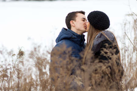 couple winter: Happy Young Couple in Winter field kissing