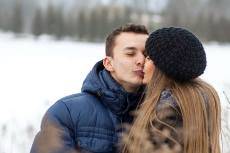 winter field: Happy Young Couple in Winter field kissing