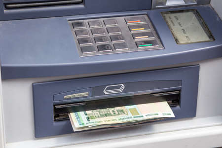 automated teller: Cash withdrawal. Belorussian ruble banknotes in ATM