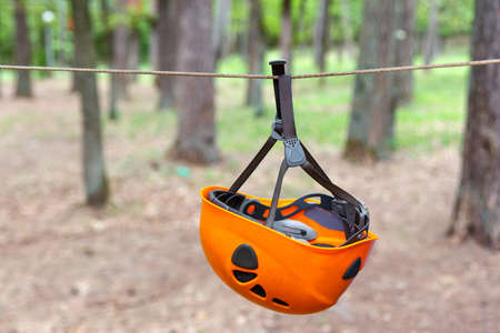 tense: Climbing helmet hanging on the tense rope Stock Photo