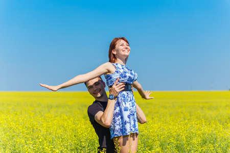 raises: Couple in love, man raises woman up into the sky
