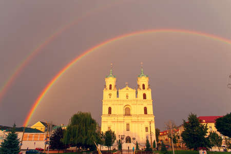 francis: GRODNO, BELARUS - AUG 15: St. Francis Xavier Cathedral after rain in sunset light on 15 August, 2016 in Grodno, Belarus.