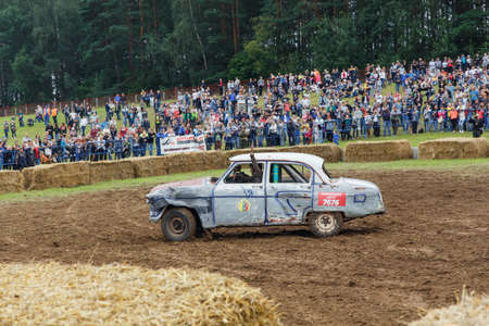 GRODNO, BELARUS - AUG 13: The winner of the battle celebrate the victory on Car fighting for survival on August 13, 2016 in Grodno, Belarus Editorial