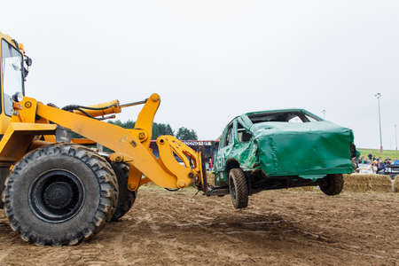 destroying the competition: GRODNO, BELARUS - AUG 13: The forklift evacuates The figth Car from arena fights for survival on August 13, 2016 in Grodno, Belarus