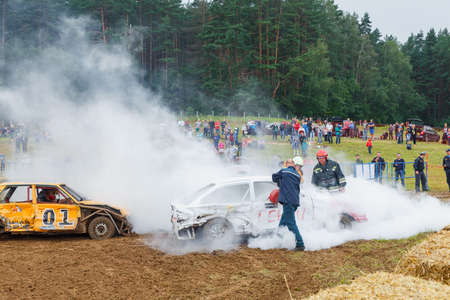destroying the competition: GRODNO, BELARUS - AUG 13: Firefighters extinguish a car on Car fighting for survival on August 13, 2016 in Grodno, Belarus