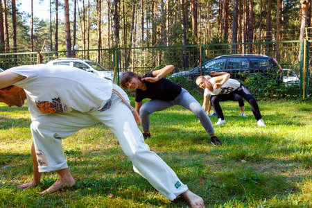 sep: GRODNO, BELARUS - SEP 09: Group of capoeira students with master teacher in FICAG school in Grodno, Belarus at September 09, 2016 Editorial