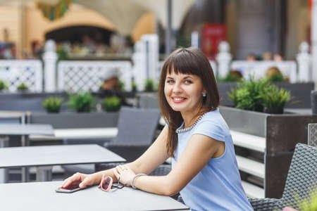 Portrait of beautiful caucasian woman in outdoor cafe