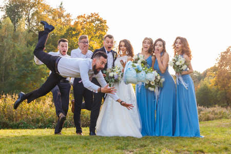 Loser drops the wedding cake during the wedding ceremony Stock Photo