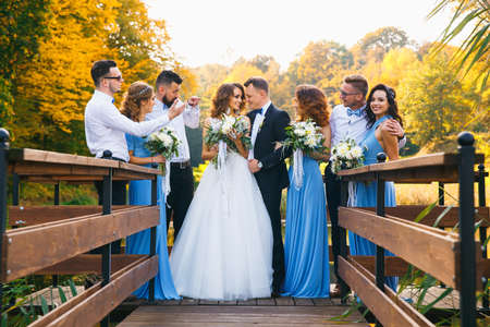 newly: Groomsmen and bridesmaids with newly married on wedding ceremony