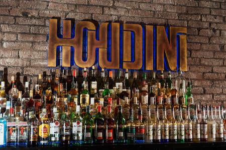 intoxicate: GRODNO, BELARUS - NOV 7: Alcohol bottles on a bar at the gastrobar HOUDINI in Grodno, Belarus, November 7, 2015